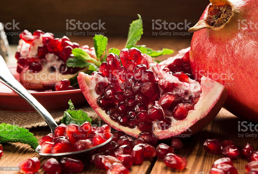 pomegranate on the wooden table stock photo