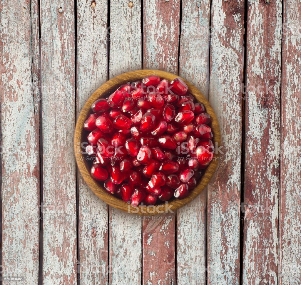 Pomegranate on wooden table with copy space stock photo