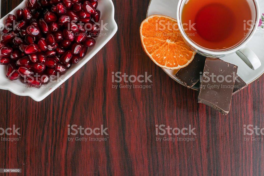 pomegranate seed with tea stock photo