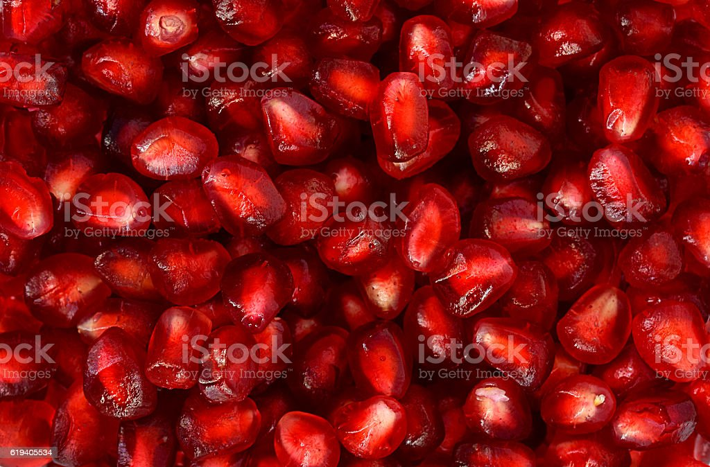 Pomegranate seeds background stock photo