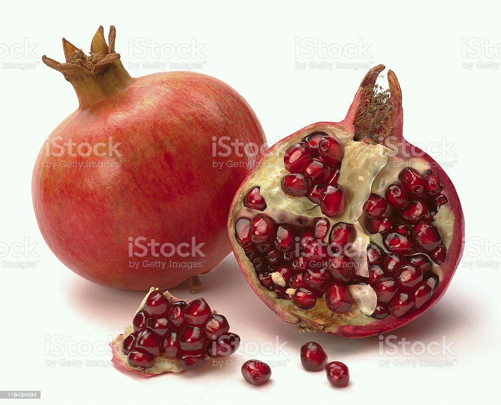 Pomegranate whole and open-face with seeds stock photo