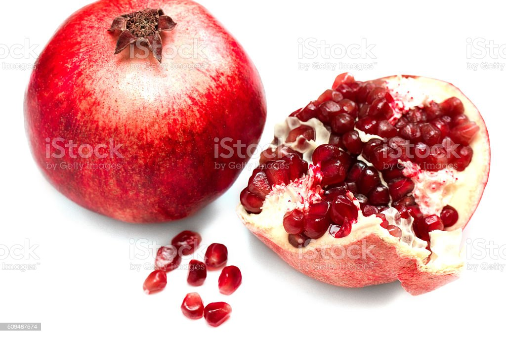 pomegranate with grains on a white background stock photo