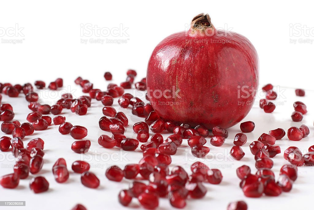 Pomegranite with Scattered Seeds stock photo
