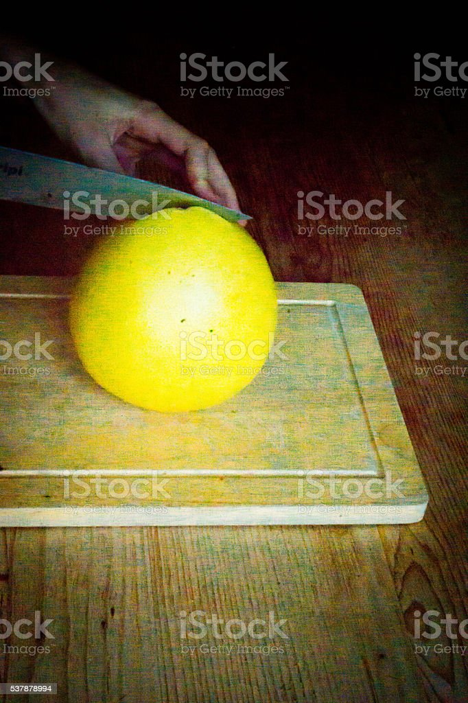 Pomelo being cut stock photo