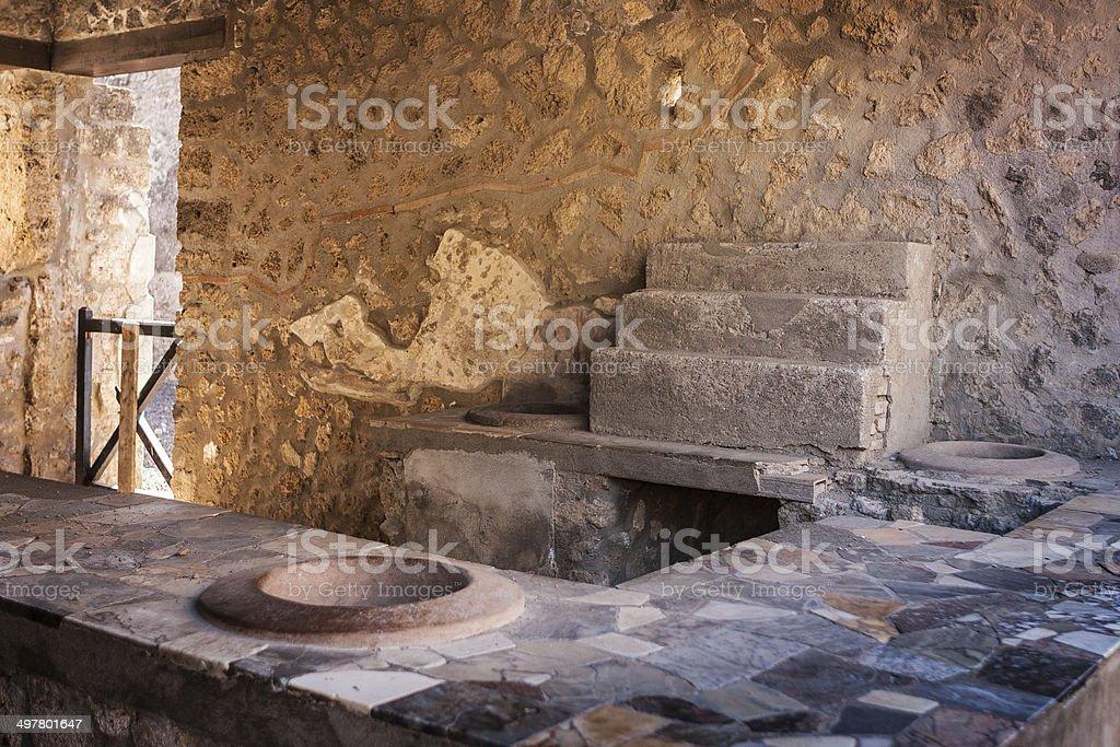 Pompeii, Italy - Ancient wine shop stock photo