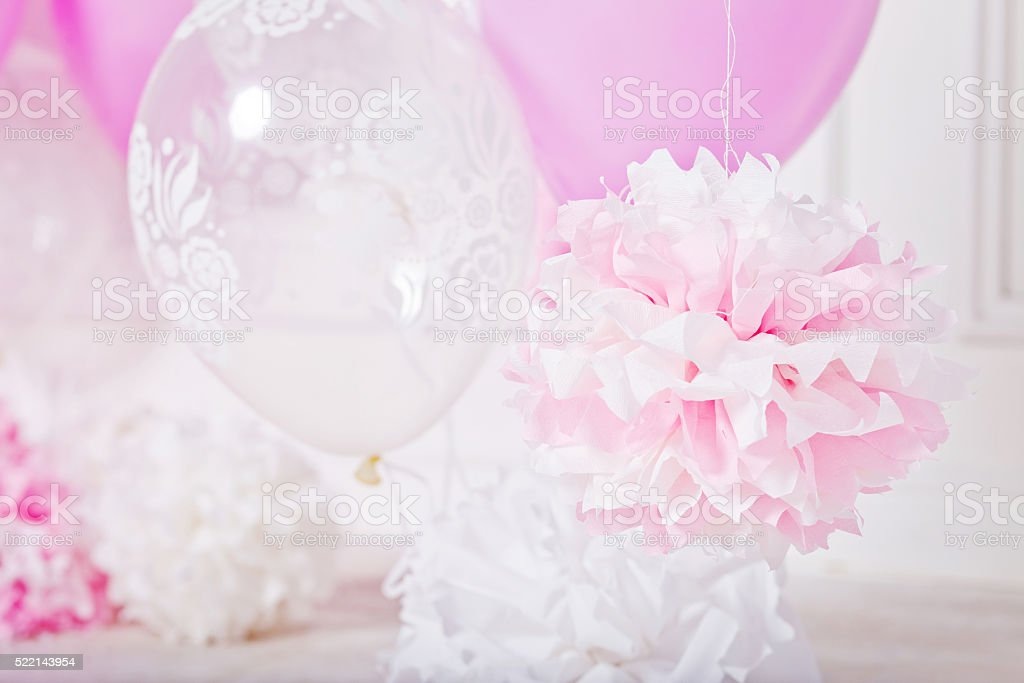 Pompoms and ballons for a party. Pink and white colors stock photo