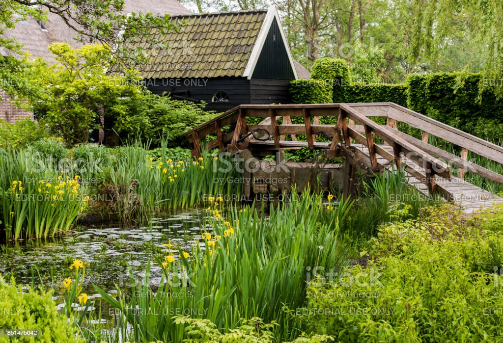 Pond and Bridge at Giethoorn stock photo