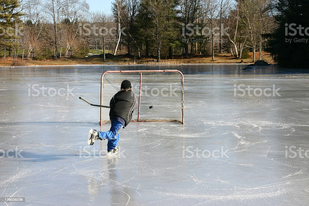 pond hockey wrist shot royalty-free stock photo