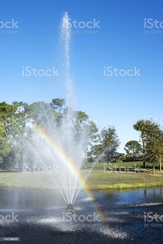 Pond Water Fountain with Rainbow. royalty-free stock photo