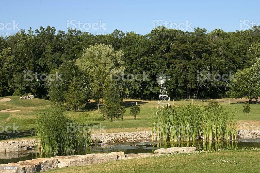 Pond & Windmill stock photo
