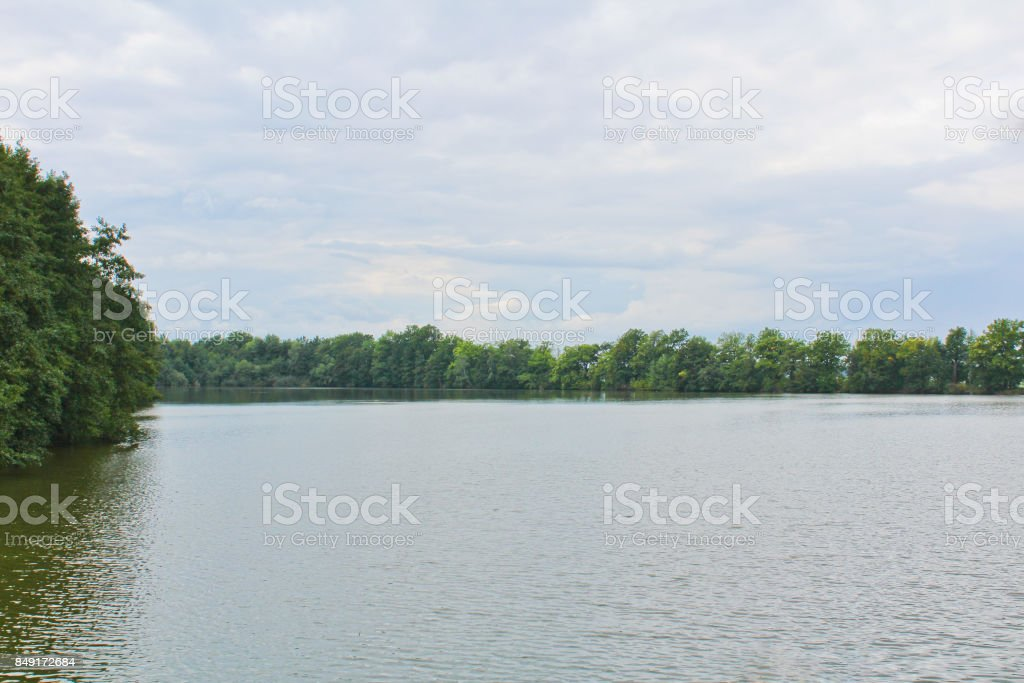 Pond with trees and blue sky, Czech landscape stock photo