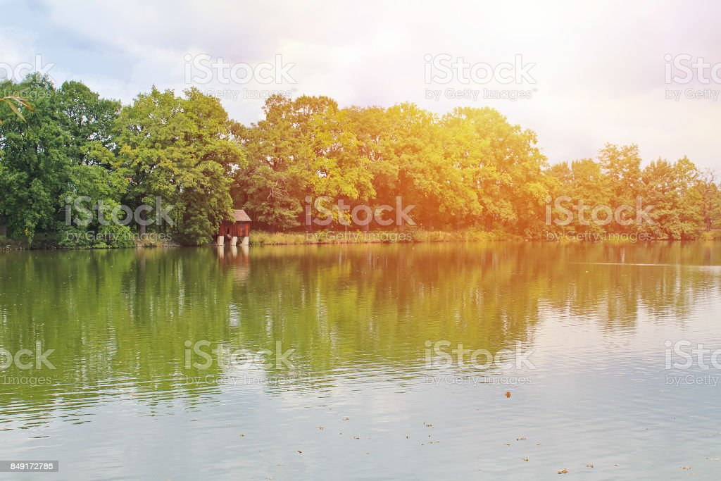 Pond with trees and granary building, Czech landscape stock photo