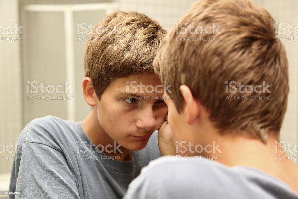 Pondering teenage boy royalty-free stock photo