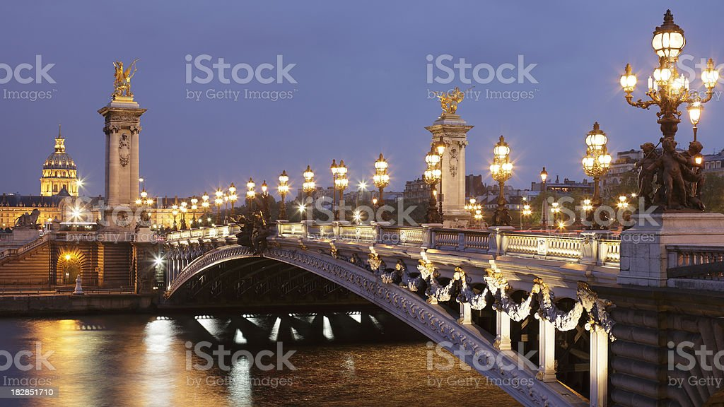 Pont Alexandre III and Les Invalides at night stock photo