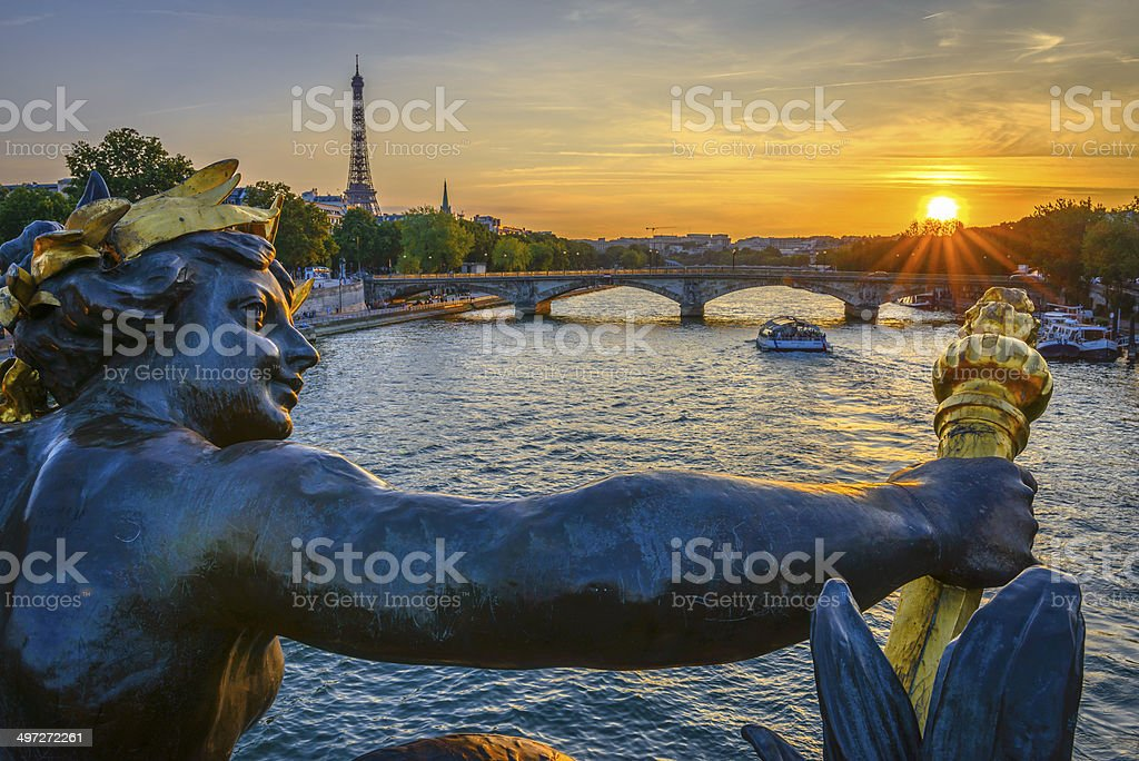 Pont des Invalides and Eiffel tower at sunset stock photo