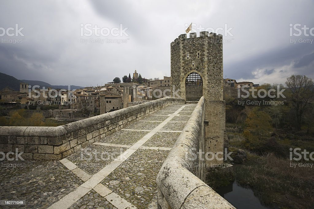 pont the Besalu, Catalan medieval bridge and tower _ Horizontal. stock photo