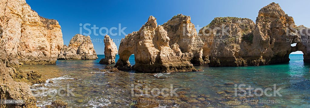 Ponta da Piedade with eroded rock formations and natural arches stock photo