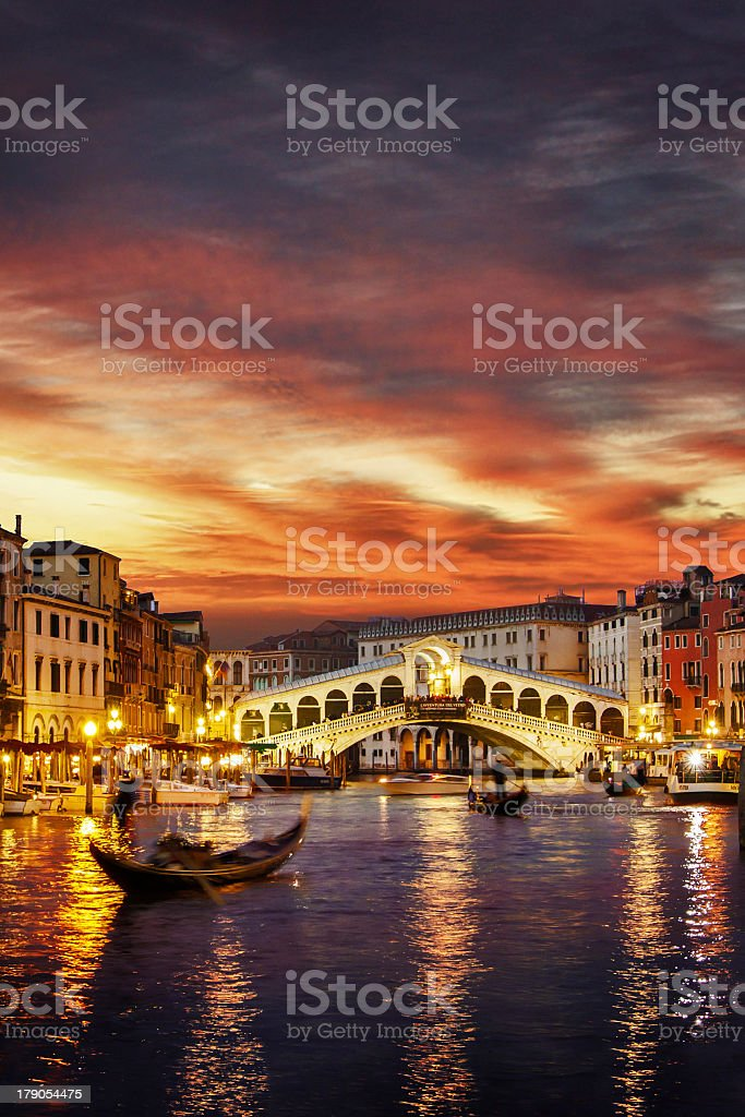 Ponte Rialto and gondola at sunset in Venice, Italy stock photo