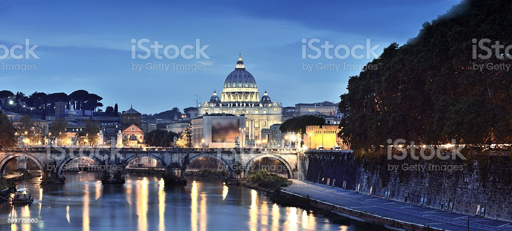 Ponte Sant' Angelo bridge and St. Peter's Basilica At Dusk stock photo