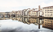 Ponte Vecchio and historical buildings are mirroring