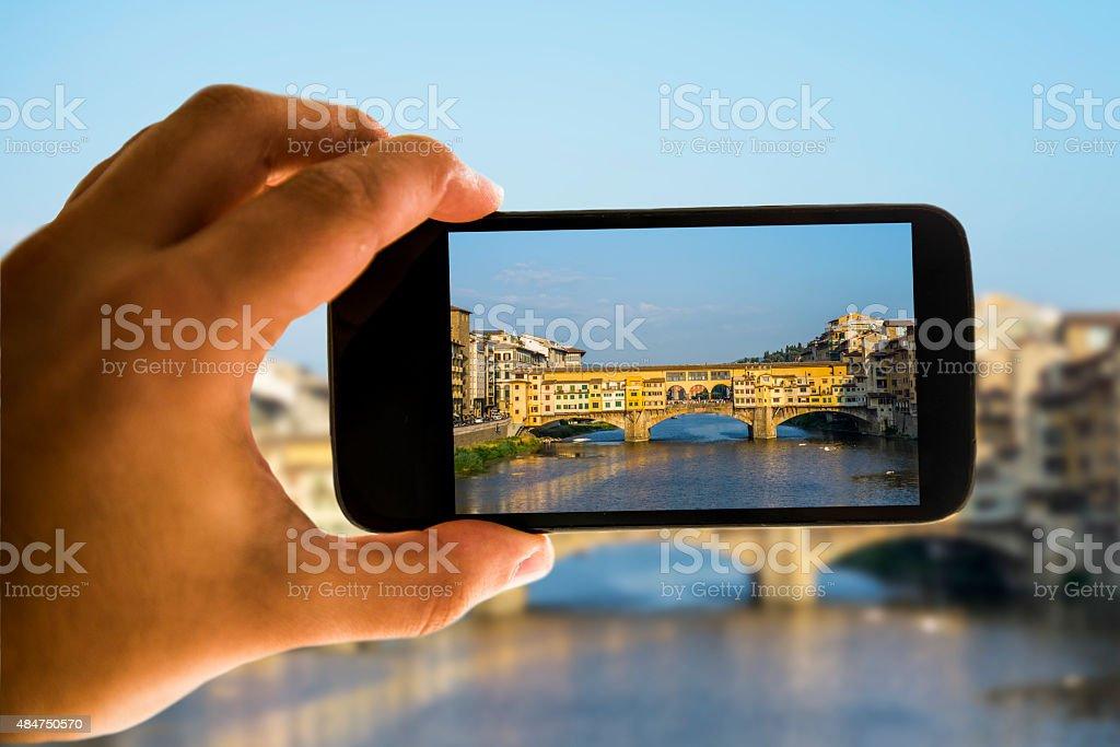 Ponte Vecchio on mobile phone screen stock photo