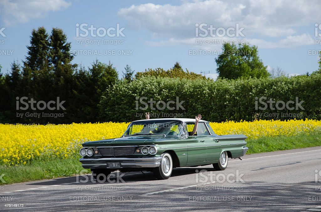 Pontiac Bonneville 1960 on the road stock photo