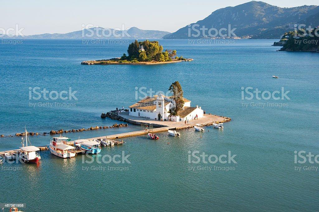 Pontikonisi and Vlacheraina monastery seen from Kanoni on Corfu, Greece. stock photo
