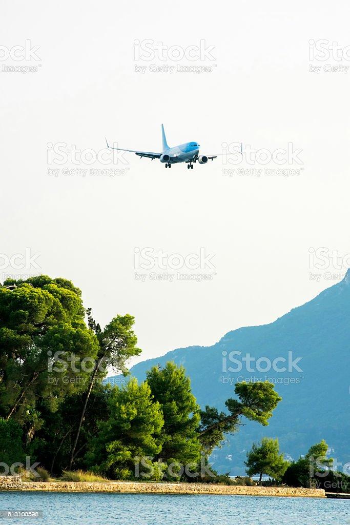 Pontikonisi with airplane seen from Kanoni in Corfu, Greece stock photo