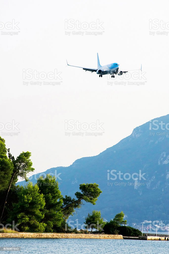 Pontikonisi with airplane seen from Kanoni in Corfu, Greece stock photo