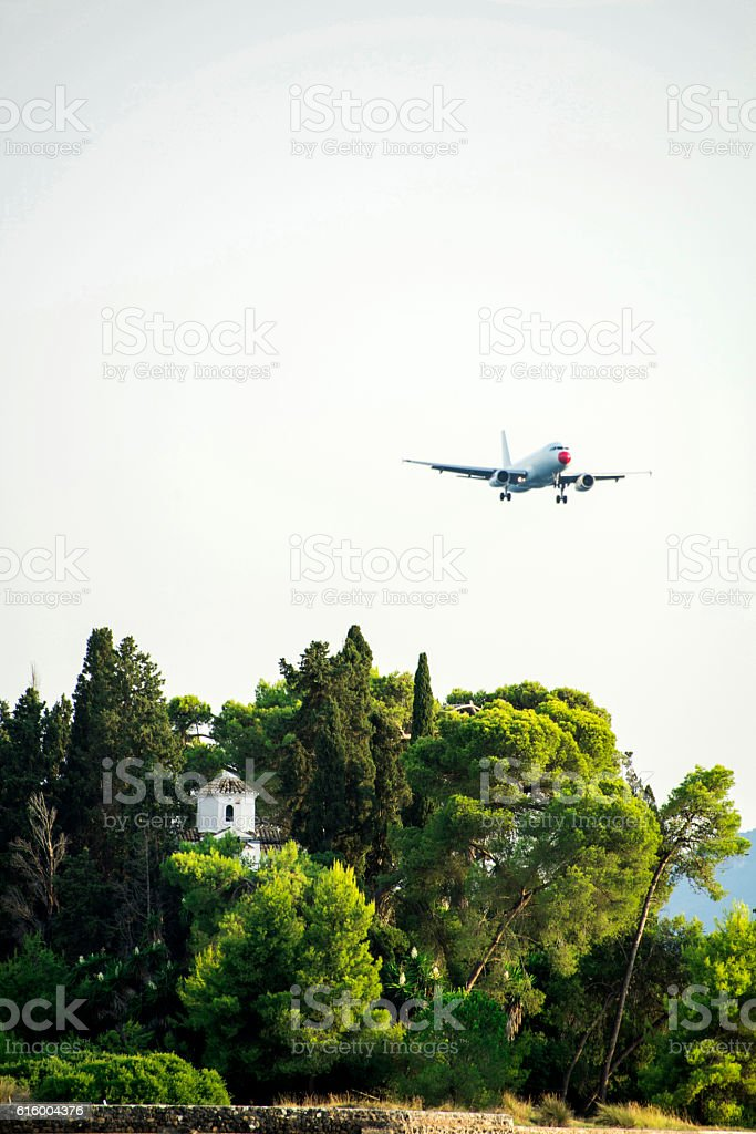 Pontikonisi with airplane seen from Kanoni stock photo