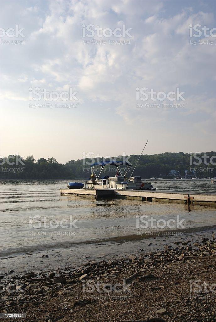 Pontoon Boat at Dock stock photo