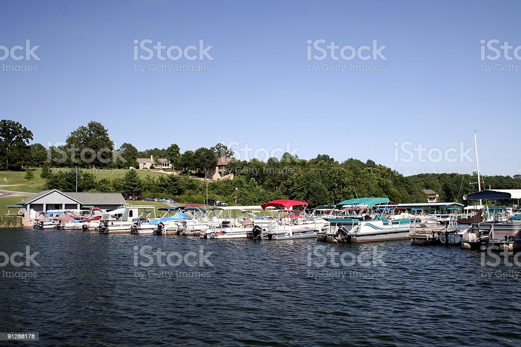 pontoon boat dock stock photo