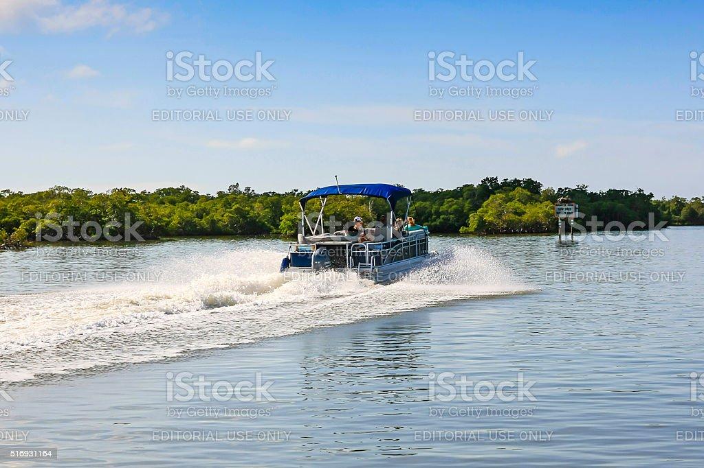 Pontoon boat in Haldeman Creek in Naples, Florida stock photo