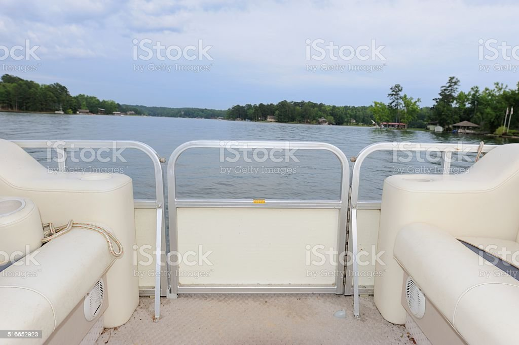 Pontoon boat on lack stock photo