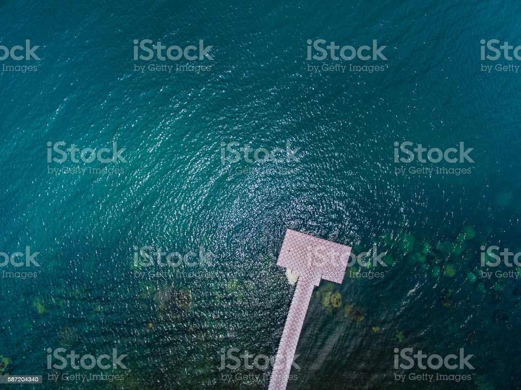 Pontoon bridge stretching into the distance in deep water stock photo
