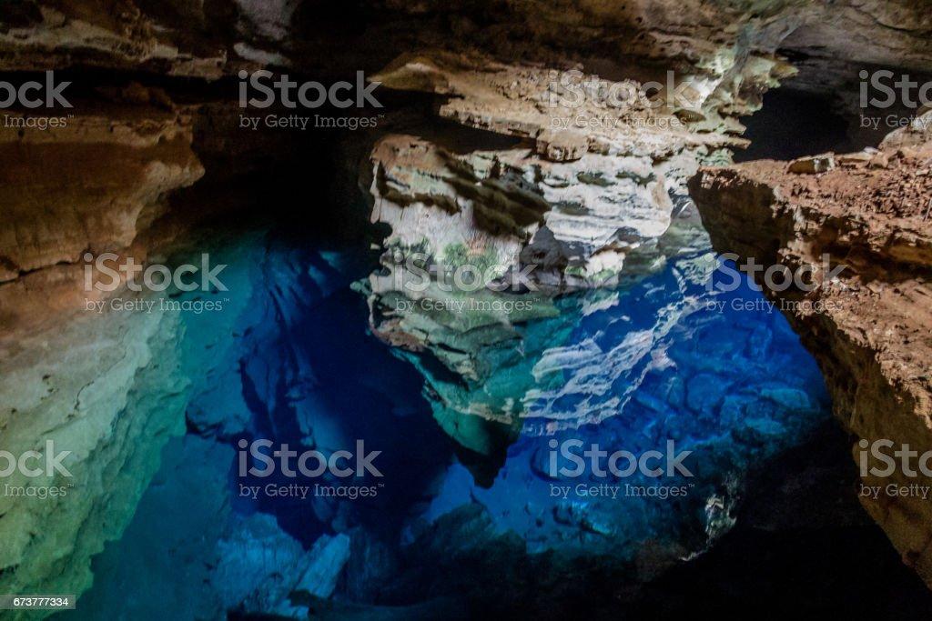 Poço Azul, Cave with blue transparent water in Chapada Diamantina - Bahia, Brazil stock photo