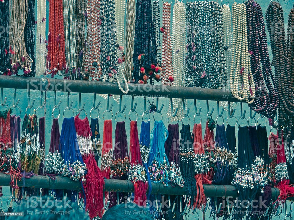 pooja items and colorful holy bands made by threads stock photo