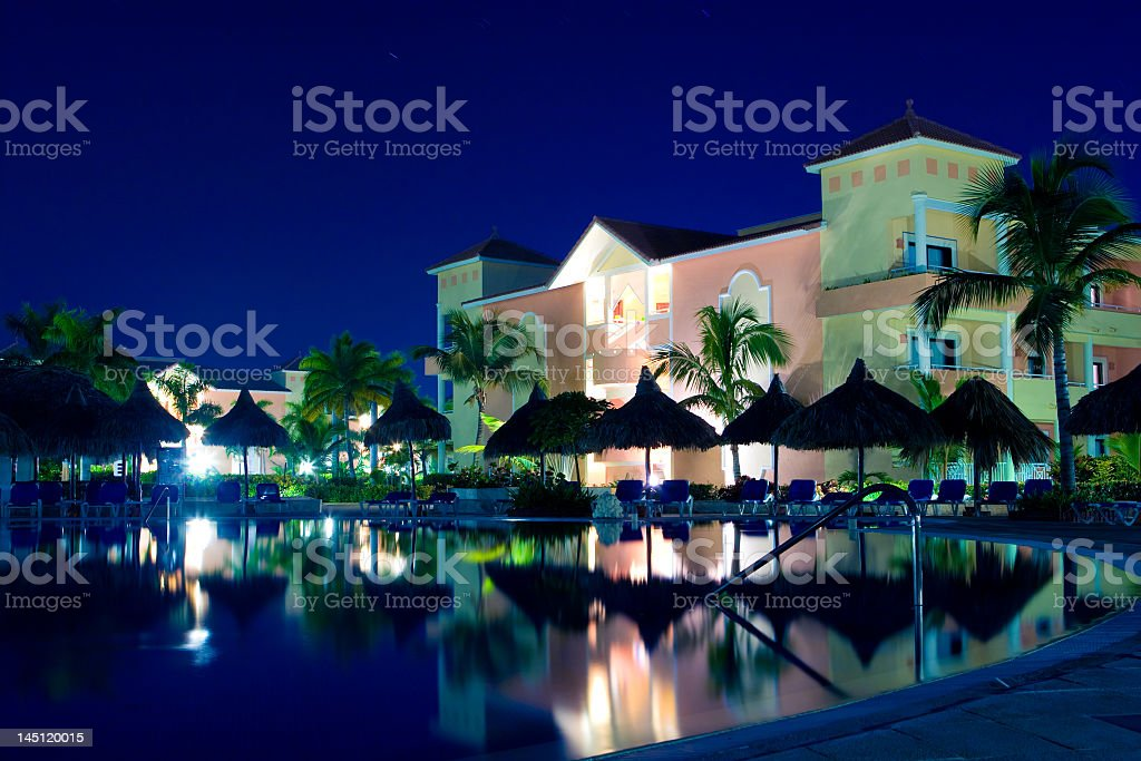 A pool adjacent to a hotel resort royalty-free stock photo