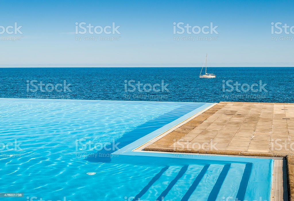 Pool and ocean relaxation stock photo