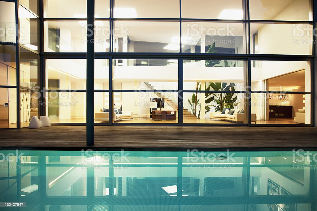 Pool and windows of modern house royalty-free stock photo