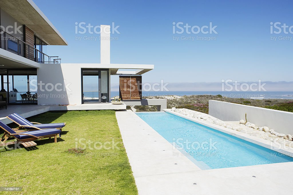 Pool and yard with view of water royalty-free stock photo