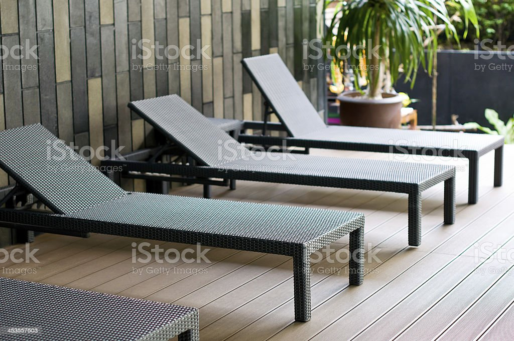 Pool area with Lounge chairs royalty-free stock photo