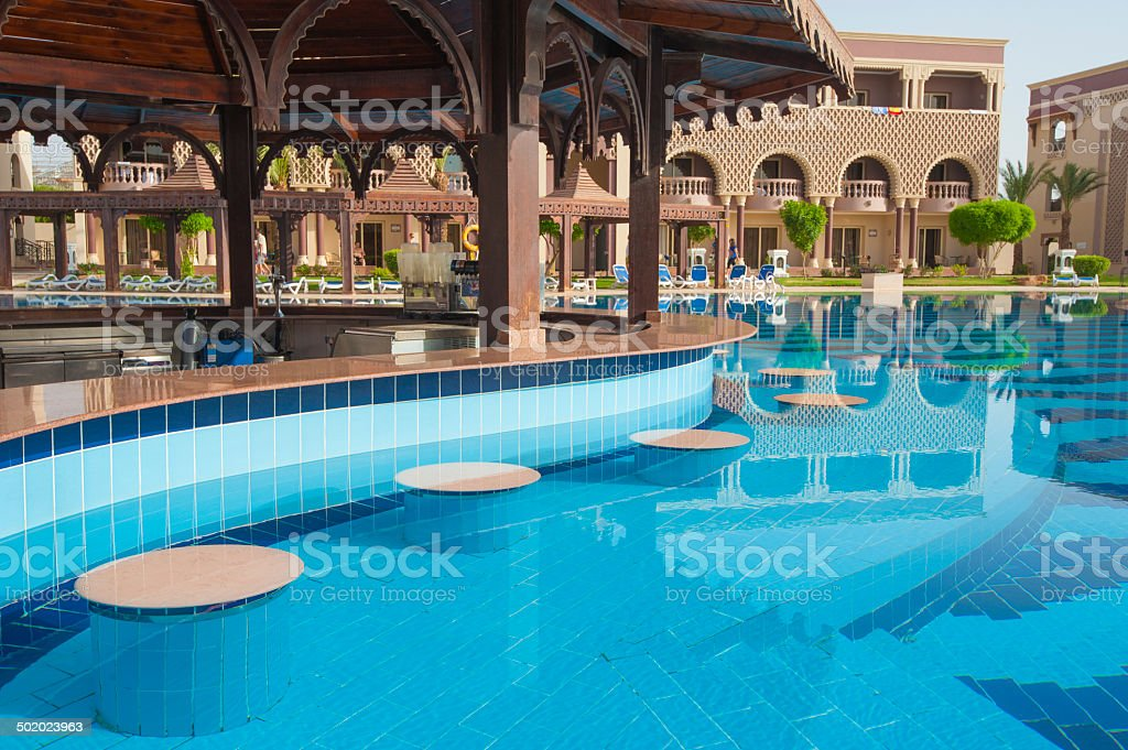 Pool bar at tropical hotel stock photo