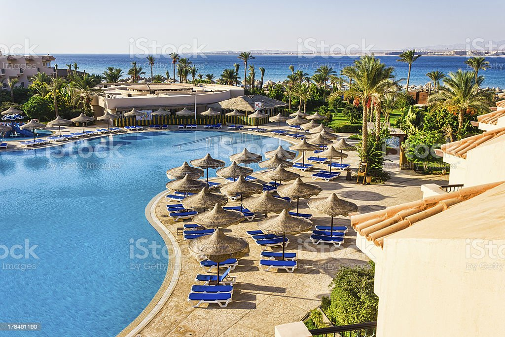 pool, beach umbrellas and the Red Sea in Egypt stock photo