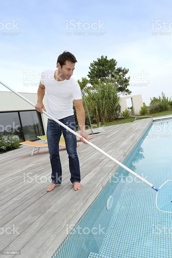 Pool cleaneing by man royalty-free stock photo