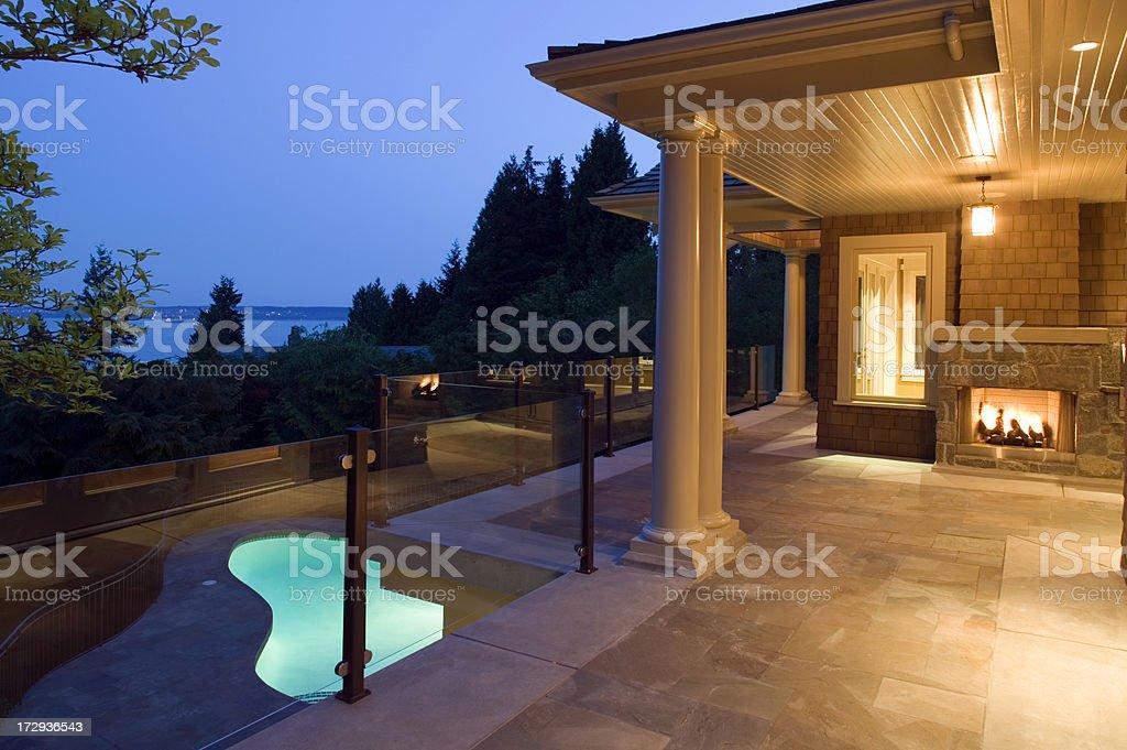 pool deck house dusk stock photo