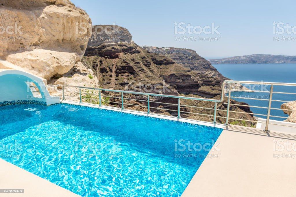 Pool & landscape in Santorini stock photo
