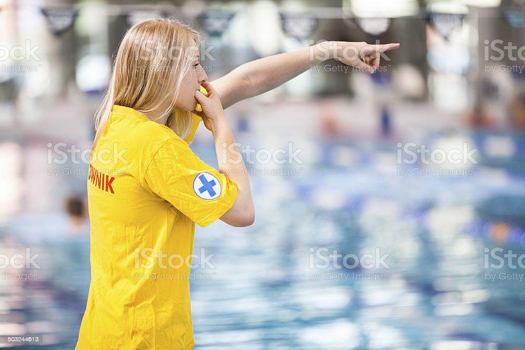 Pool lifeguard at a swimming pool stock photo