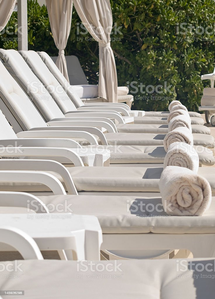 Pool Lounge Chairs royalty-free stock photo