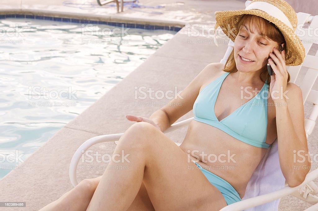 Pool Mom on the Phone stock photo